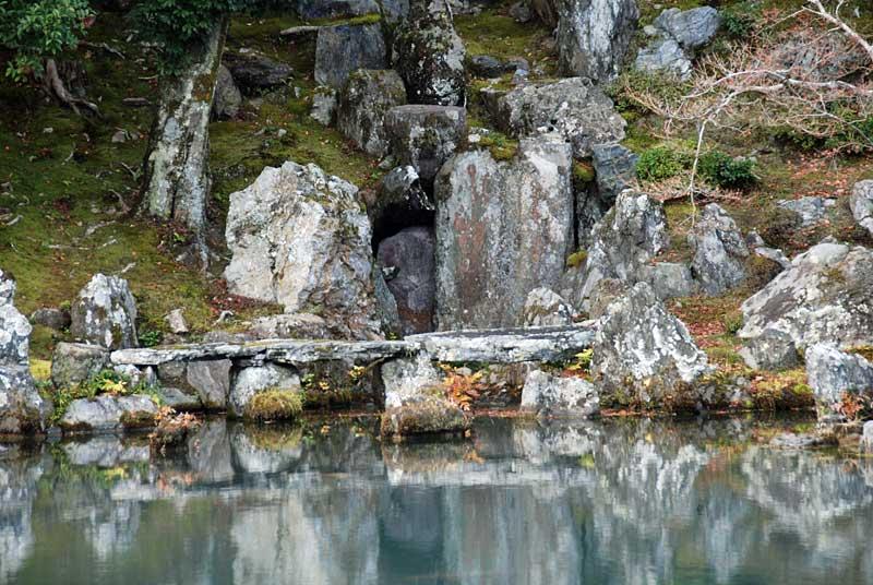 a three span stone bridge in the garden of tenryu ji